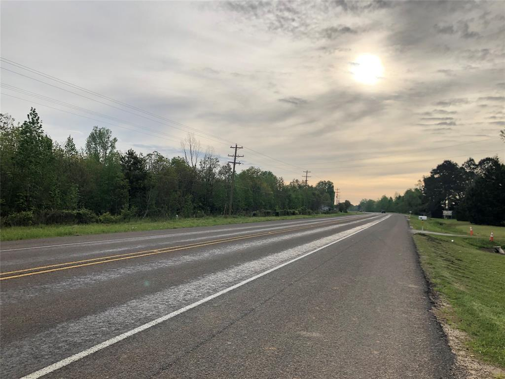 UNLIMITED POSSIBILITIES! Don't miss out on this great opportunity to own Great HWY 105 frontage. This rare find is very close to intersection of HWY 146 and HWY 105.