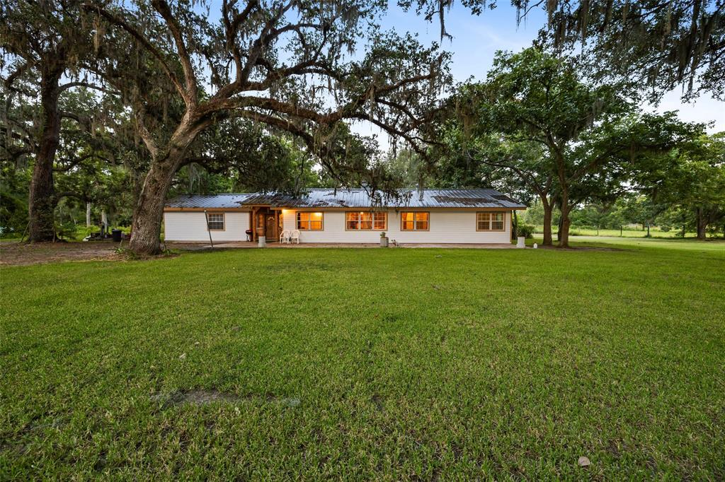 Beautifully maintained 3 bedroom home situated on 3 partially cleared acres with mature oak trees in the peaceful Wild Peach community West of the Brazos. The entry welcomes you with gorgeous stained glass and attractive stone flooring. Impressive floor plan includes a breakfast area and private study with stone flooring and built in shelving. Spacious living room boasts large windows overlooking the fenced back yard, stunning wood floors and a cozy wood burning fireplace with brick surround. The kitchen is complete with custom tile backsplash, porcelain tile countertops and ample storage space. Relaxing master suite offers walk in closet with built in shelving. Schedule your showing to view this exceptional property today!