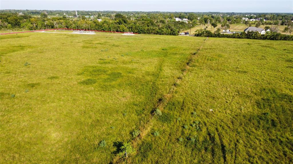 812 Acres of unincorporated land that has been mostly cleared and runs along Highland Bayou.  Half the property is in Galveston County and half is in Brazoria County. Fully fenced ready for your livestock. Seller will divide into 100 acre sections with easement to back of the property.