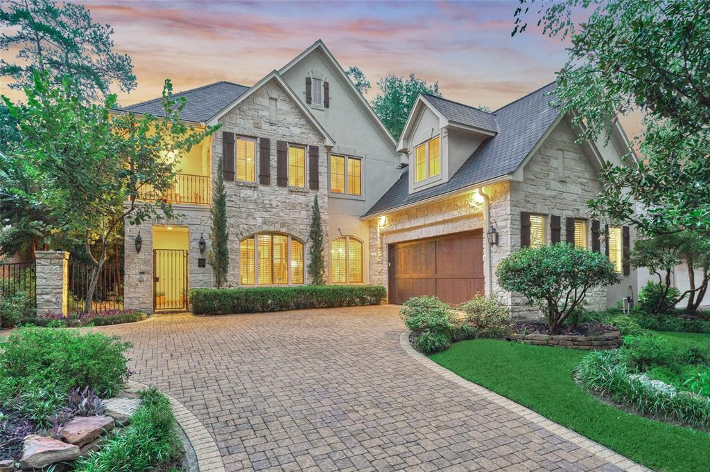TRUE FRENCH INSPIRED HOME! Walking distance to The Woodlands amenities & just across the street from the golf course! Low maintenance Pool Doubles as a Large Hot tub w/jets! European Masterpiece - Venetian plaster finish, gorgeous wood beams, stone work in kitchen reminiscent of wine caves! Elegant yet comfortable.  Sunroom off living rm features 2nd fireplace & doors that slide open to the pool area, perfect for indoor/outdoor living. Open floorplan,high ceilings,abundant windows, Incredible Kitchen w/custom stone fireplace to grill or bake pizzas,gas range,beautiful hand painted island! Master is privately located at back of home w/access to the pool area. TONS of Built-in Storage...Huge Pantry, Nice Sized Laundry, Oversized Garage w/Workshop! Upstairs has 3 more bedrms, 2 bathrms, a Bonus rm that can be a nursery/craft room & a walk in storage room! Back bedrm & game rm have 2nd set of stairs & can be guest quarters! This home exudes old world charm w/modern luxuries! WELCOME HOME!