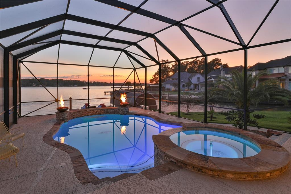 Welcome home to Prestigious Lake living in Bentwater on Lake Conroe! When you enter the Bentwater community you will be greeted by the friendly staff at the manned gate. Not only is this gorgeous home in the golf course community but it is also waterfront living with your own private covered boat slip w/boat lift & two jet ski lifts which has all been recently redone and updated. The beautiful pool w/waterfall & firepit features & hot tub are screened in. Enjoy your entire day on the large covered back patio. Inside is just as gorgeous as outside plus you have all the lake views while inside. This open concept home has a beautiful kitchen w/granite countertops, stainless steel appliances that opens to the dining & living room areas. The primary bedroom & bathroom as well as another bedroom & full bathroom are downstairs plus a nice study w/french doors w/gorgeous built-ins. Upstairs features a gameroom, huge media room, bedroom & full bathroom and an extra room for whatever you desire.