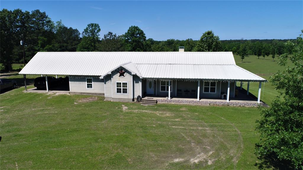 This 80.408-acre property is picture perfect with a pretty lake and 80% pastureland fenced with hog proof wire and 20% wooded. Metal cattle pens and covered chute area make working cattle a breeze! The 2/2 impressive home offers an open concept with vaulted ceilings. The large living area has a rock double-sided wood burning fireplace. Kitchen offers lots of custom cabinets, abundance of counter-space wrapped in granite counter-tops, and stainless appliances.The large master offers a large walk-in closet and a fabulous bath with a garden tub and walk-in shower. There is a guest bedroom and an additional small bedroom. This home is complete with stained concrete floors and an instant hot water heater. Outside, this home has wraparound porches where you can enjoy the views, an attached 2-car carport, and a metal roof. In addition of being an amazing home place, there are 3 mobile home spots on the property with utilities in place. Call today!