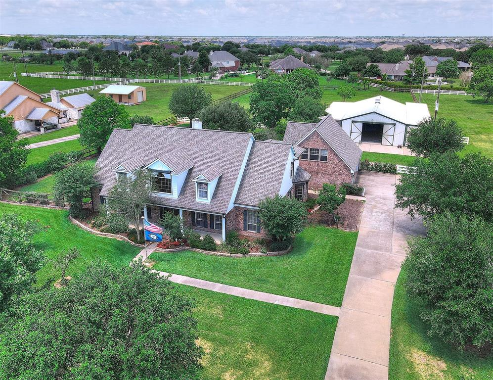 Absolutely gorgeous 4 acre horse ranch with 4 stall barn, RV & horse trailer parking. Custom built 4541 square foot home has separate garage apartment with separate balcony. This 4 bedroom home has multiple optional/flex rooms to create additional bedrooms, formal living & dining, office, media & game room, two balconies, oversized pool & hot tub, covered patio, 3 car garage, loafing shed, camper hookup, hurricane shutters, laundry chute & folding table. Barn swing out feeders, tack room, workshop & storage, fruit trees, grape vines & more.