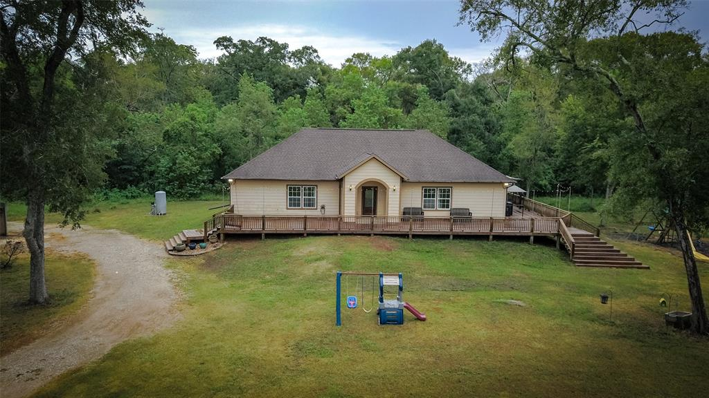 Welcome home to 17903 Oak Bayou Road! This home offers 1,860 sq/ft of living space with 3 bedrooms, 1.5 bathrooms,  11+/- acres, and is zoned to Needville ISD! You'll love all the incredible features this home has to offer, including an open floor plan, lovely living room, kitchen island, and wrap around porch! This home is minutes from George Ranch, George Observatory, and the Brazos Bend State Park with easy access to HWY 59. Schedule your private showing today!