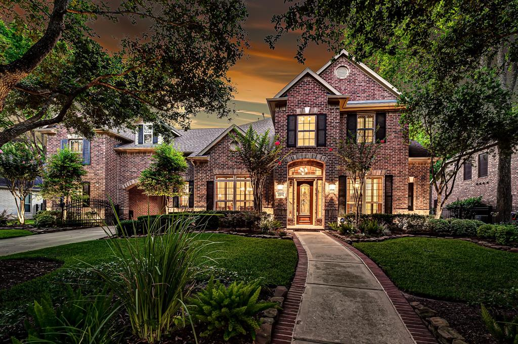 """Unique opportunity to own this executive David Powers home on spectacular 1/3 acre golf course lot in Seven Meadows! With views of hole #10, this 4 bedroom home features FRESH DECORATOR PAINT (2019), a recent roof (2016), Trane HVACs (2017), water heaters (2018), pool pumps & filter (2020). Custom details include plantation shutters, built-ins, island kitchen, integrated indoor & outdoor Bose sound system, gated porte-cochere with add'l parking & double crown molding! Open concept first floor features panoramic outdoor views, expansive master suite, formal dining, study, breakfast & sun room. Game & media rooms with theater seating & dry bar, 3 bedrooms, 2 full baths, 10' homework desk & """"secret"""" bonus space complete the 2nd story. Step outside & enjoy the sparkling pool, spa, fire pit & waterfall, pool half bath & outdoor kitchen! Large green space & lush landscaping make the backyard a space you'll use all year. Zoned to Holland, Beckendorff, & Seven Lakes in acclaimed Katy ISD!"""
