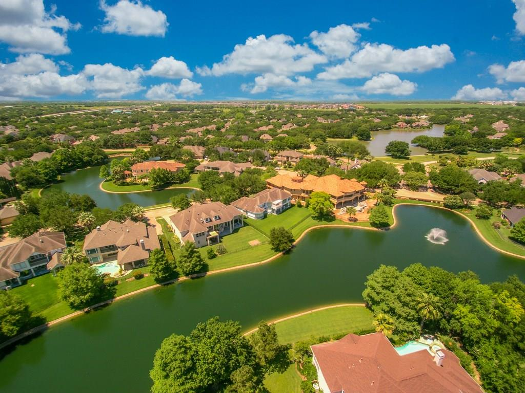 "This Westport Home built in sought after Pointe Royale gated community w/ lake views on both front & rear is sure to impress! Double French doors lead you to a private study w/built-ins, this is the perfect ""work at home"" space. A home built for entertaining, the spacious 2019 built gourmet island kitchen w/Wolf gas stove flows into the family rm where you have large windows to capture the view! The expansive primary bedroom w/amazing lake & fountain views also features a spa like bath w/double vanity, large walk in shower w/multiple sprayers & a soaking tub! The second floor has 4 additional bedrooms, 3 have private balcony access, game room also w/balcony access & a guest suite! Don't miss the third floor ""BONUS"" room. This could be a media room or divided in to two additional bedrooms. 2017 Lutron whole house lighting system controllable from App. The pool size backyard is your very own oasis; built in outdoor grill & extended covered patio, it just awaits your imagination!"