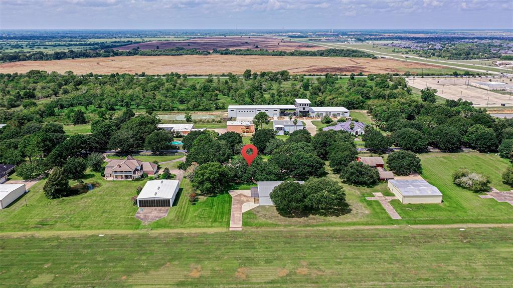 This 1.5 story Covey Trails Airpark Home is located at midfield on the 3350 ft long by 100' wide grass airstrip! The 1.3+ acre property is definitely one of a kind! Traditional on the outside, while Exotic on the inside! At almost 3800 sq ft, this 4 bedroom and 3.5 bath has been expanded by taking in the garage and the back patio. By removing walls, the gathering areas are perfect for entertaining. Enjoy the expansive view to the runway and backyard. Gorgeous chef's kitchen is open to the huge family room. Custom mural paintings adorn every wall. A large media room/man cave in the converted garage. A private enclosed pool area with a cascading waterfall and fire pit in the rear. The airplane hangar is 75' x 60' and can handle multiple aircraft - also comes with a 42'wide x 12' high hydraulic hangar door and has ample concrete for your apron out front. Hangar has an air conditioned work shop as well as a one bedroom apartment. Identifier: X09