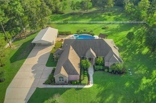 Welcome to his beautiful 4/3.5 in Lake Windcrest on an elevated 12 acre, horse friendly, golf course community. Fenced and invisible fenced 4 acre homestead, pond, fruit trees and this home backs to Scarlet & Grey Farms so no rear neighbors! Some features include fresh interior paint, art niches, crown molding, new granite on the summer kitchen, spacious rooms and L.E.D. lighting, two tankless water heaters, automatic gated entry. Private study, 2 dual sided fireplaces. Granite counters, stainless steel appliances, double ovens, a coffee nook, breakfast bar and butlers pantry with glass front cabinetry. Beautiful views of your pool and a dual sided fireplace shared with your master bath featuring two sinks, a vanity, jacuzzi tub and large walk in closet! Your backyard Has a covered patio with an outdoor kitchen, multiple seating areas, fire pit, updated salt water pool and spa with water wall and plenty of room to play! Enjoy entertaining under the picturesque Texas sunsets.