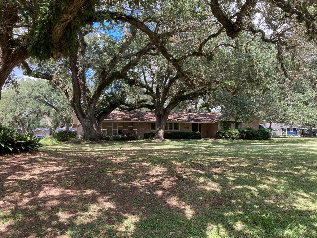 Mature live oak trees surround this 3-2-2 ranch style home situated on a spacious .8 acre corner lot. The home is located in the quiet Pyssen Live Oak Estates subdivision in Boling School District. With a great floor plan, this house has lots of potential. The kitchen and dining areas include roller-driven cabinet pull-outs, ample drawer/cabinet space and other custom built-in features. A custom study nook (desk/drawers) is provided neatly near the kitchen. There is plenty of closet space including an entryway coat closet and a large walk-in closet in the master bedroom. Sunsets can be viewed nicely from the sunroom or covered back porch that face westward. The attached 2 car garage has lots of space with built in storage cabinets. Your guests will have plenty of room to park on the concrete driveway. Out back there is a 24' X 20' storage building/workshop and a greenhouse. This 2039 square foot (living area) all electric home is well built and has never flooded.