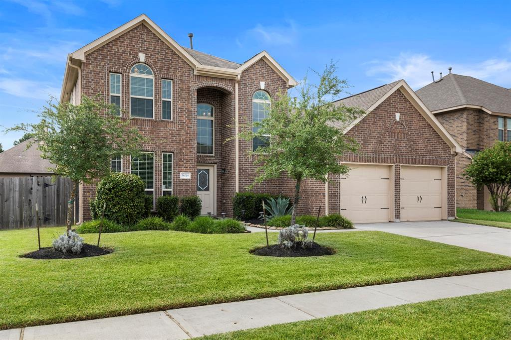Classic Brick Gracepoint home in Legends Trace. 4 bedrooms (primary suite is downstairs), 3.5 baths and large gameroom up that is the media room for this family. Great curb appeal! Legends Trace Community Center is just a few houses away with a pool and playground for the kiddos. The formal dining room serves as the office/study for work at home convenience. The kitchen is spacious and has granite counters, stainless appliances and under counter lighting. The premium lot is larger than standard and has a covered porch with an extended flagstone patio creating more of an outdoor living space. The condition of home is very good and original owners have loved the area as much as the home!