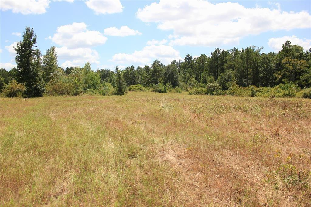 Looking for a beautiful piece of land away from the city hustle yet only a stones toss away from Houston, Conroe, and the Woodlands? This is it folks! Gorgeous and rare property located in the sought after school district of Anderson-Shiro. This 19.276 corner lot has much to offer. Property has been cleared and is ready for you to build that dream home in the country you've always wanted. Property offers many types of hardwoods and several places to build a home. Property sits higher in the front and naturally slopes toward Little Caney Creek in the back. County maintained roads and electric availability at the road. Granite Ridge Ranch is lightly restricted to help maintain property values.  Please call listing agent for any questions. Drawings are approximate.