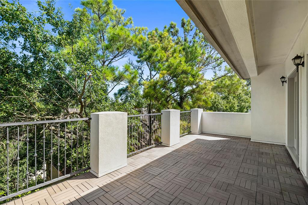 Off of the fourth bedroom is an expansive and quiet patio area with endless possibilities.