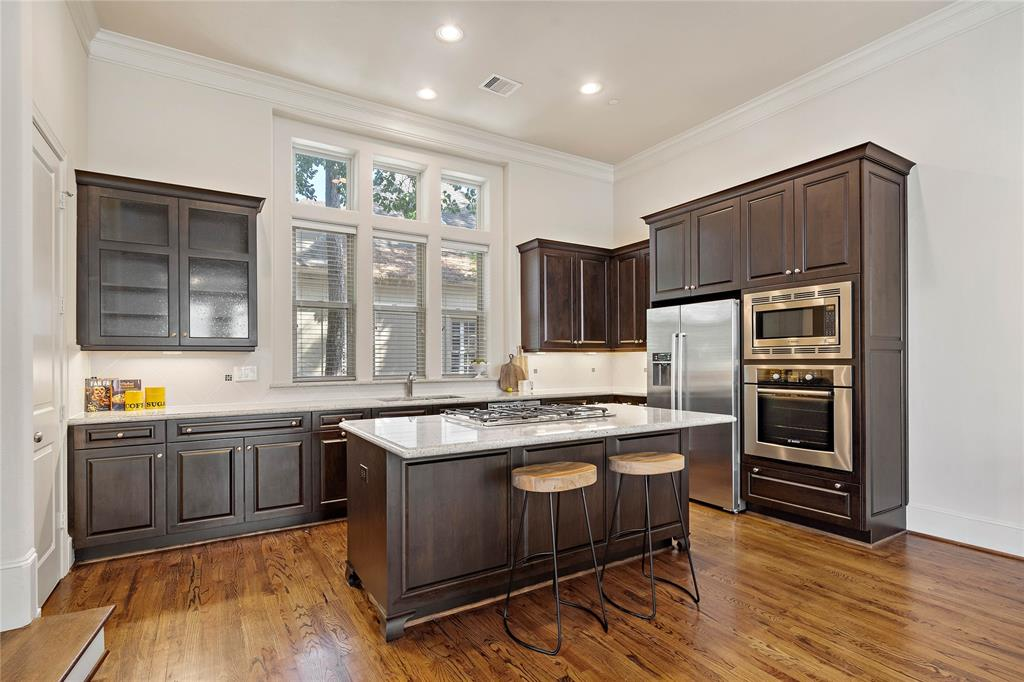 The large kitchen is complete with granite counter tops, all Bosch appliances and bar seating.