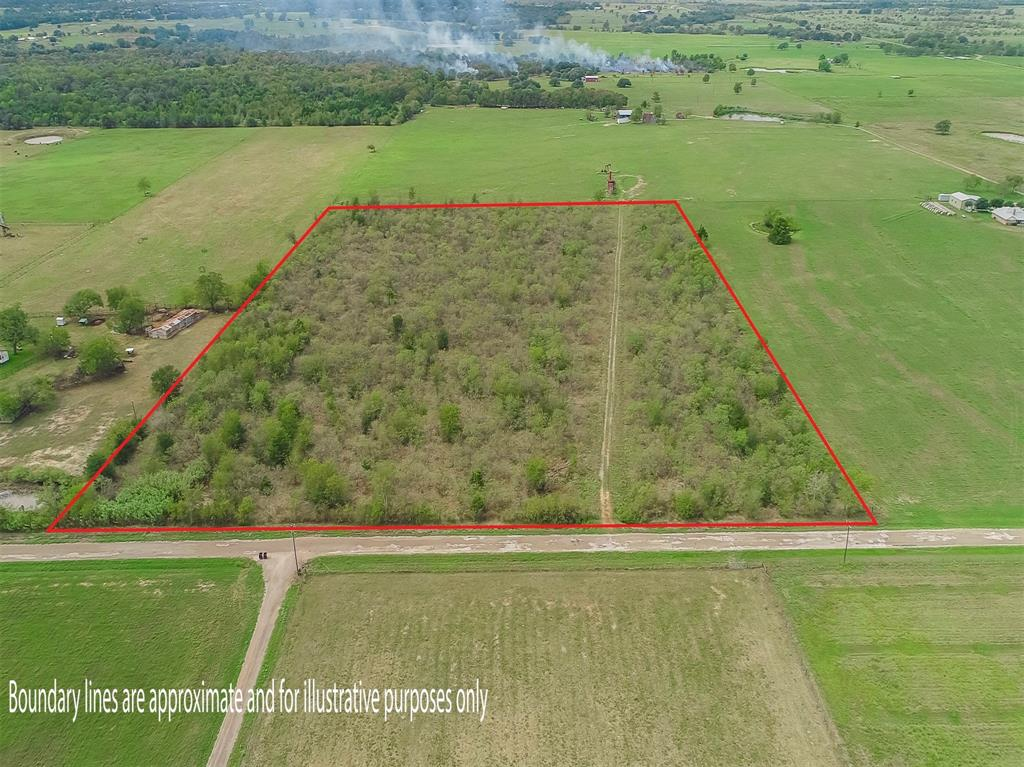 Approx. 15.5 Acres of undeveloped land outside Dime Box in eastern Lee County. Property dimensions are 705' of CR frontage by 950' deep. Wooded land with gravel road running through the property. Perimeter fenced on 3 sides. Lee County Water lines available and overhead power lines located on adjacent properties. No restrictions, no zoning, no floodplain; located outside the city limits. Property is subject to existing mineral lease and 25% minerals will convey at asking price. No knowledge of pipeline easements. Blank slate and ready to make it your own!