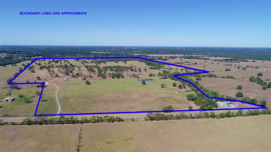 Cattle Ranch in Bedias, TX on Hwy 90 just south of Bedias, in the Anderson-Shiro School District. This beautiful ranch has a 3 bed, 2 bath bardaminium, with 2 horse stalls, a tack room , feed room, 26x36 shop  and 30x27 Carport all located on a sprawling 211.08 acres. This incredible cattle ranch has plenty of grass year round! With solid perimeter fencing and cross fencing through out, a large tractor barn, working pens, loafing shed & 5 ponds, this property is ready for Ranching! There is plenty of shade in the pastures, as the seller has neatly groomed around the trees throughout giving the foliage plenty of opportunity to flourish. The property has pipe fencing around the home & barbwire everywhere else. This is also a great recreational property, great for hunting deer & hogs along with plenty of other wildlife. With stocked ponds, nice meadows for hunting and lots of grass for cattle grazing, this is what makes a great Texas ranch! Just minutes from College station. Must See!!