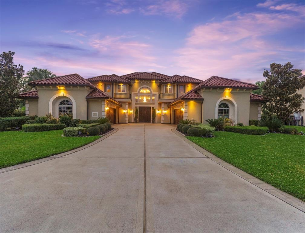Stunning 6/5.5/4 estate home located in gated community on fabulous lot w/ private backyard set on almost 3/4 of an acre & idyllically nestled between the 17th hole of the Sienna Plantation golf course, a green belt & Water's Lake. This is a rare opportunity to live in this uniquely magnificent home which is one of only 12 homes located in the exclusive, gated Sanctuary section of Sienna Plantation. The home boasts a beautifully landscaped, resort-like backyard w/sparkling pool & spa. Inside, design details are magazine-worthy including a grand double staircase, hardwoods, travertine flooring, double tray & cupola, soaring ceilings, beautiful millwork, art niches, deep crown molding, hand-painted faux walls & one-of-a-kind designer lighting. Downstairs is a formal living, dining, & family rooms, study, wine vault, gorgeous kitchen/breakfast area, a primary bedroom retreat & 2 other bedrooms, one w/a separate sitting room. Upstairs is a gameroom, media room & 3 more spacious bedrooms.