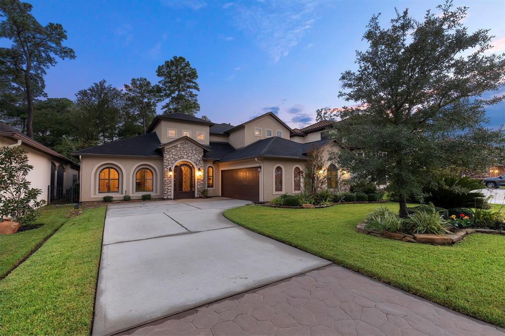 This lovely home is sitting in the superb location of Augusta Pines in a small gated enclave where you have your privacy while having wonderful neighbors all around. It is a five minute drive to The Woodlands, shopping and restaurants, plus quick to the Grand Parkway. Great curb appeal with a lovely front lawn framing the stone and stucco design. Inside, you will find accents of stone throughout the home, wood flooring, art niches, a sweeping staircase leading to upstairs, beams and floor to ceiling stone fireplace in the den, and special ceiling treatments plus quality trim work throughout the home. The cook's kitchen features a middle island with a gas cooktop, and breakfast bar. The outside provides a covered kitchen and patio with a putting green. You will love this home - come see it in person.