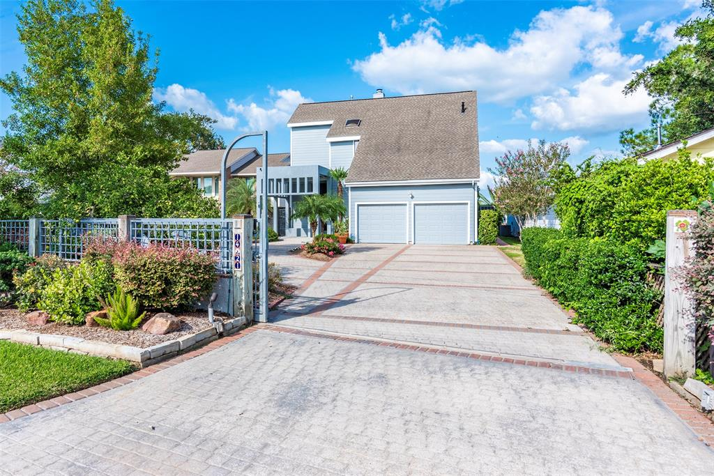 """Beautiful Bayfront home in the heavily sought after waterfront community of Kemah Texas.  Just a few blocks' distance from the Boardwalk,  restaurants, entertainment and more. This home boasts a private lighted  pier and free form pool  overlooking  the bay with breathing taking sunset and sunrise views.  Fully fenced, paved auto parking court & three car garage, large paved patios and several balconies. High vaulted ceilings with beams, open concept and wall of glass windows boast continual awesome views from most vantage points. Wood flooring , fireplace, and views, views, views!! Many updates including light and plumbing fixtures, newly installed granite counter tops in kitchen with recent exterior and interior painting.   Fabulous COI pond  and fountain.  Do not miss this opportunity to own your private piece of """"quiet"""" with immediate access to fabulous restaurants, shopping and fun. Will not last long. Call for an appointment or contact your Realtor."""