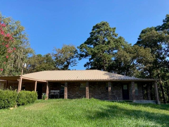MOTIVATED SELLER!!!  Look no further!  This property has SOO much potential.  Large ranch style home on almost 8 acres.  Many buildings on property to include a HUGE 40 X 80 workshop.  Beautiful trees and long driveway greet you.  A MUST see!  Home sold AS IS.