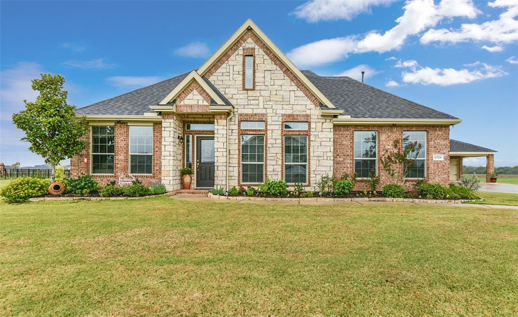 Stunning one story home situated on a 1.2 acre lot in an exclusive gated community! The home offers open living spaces, private study enclosed by French doors, 3 bedrooms, 3 car detached garage with carport & a huge fenced backyard! Lovely stone & brick facade and new front door with Texas star give great curb appeal. Upon entering is hardwood flooring that extends throughout the living spaces. The kitchen boasts maple cabinetry, granite countertops, large island, under-cabinet lighting, casual dining area with built-in desk & it connects to the formal dining room. The family room has a beautiful floor-to-ceiling stone fireplace. Spacious owners retreat offers an elegant tray ceiling with double crown molding, dual granite vanities, jetted tub & separate shower. Fresh interior & exterior paint. New Culligan water softener included! Ceiling fans in all rooms. New automatic sprinkler system. Don't miss this amazing home!