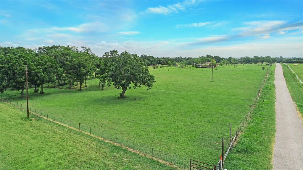 At just over 16 acres, this is the perfect setting for a custom home with rolling acreage, stocked pond, and tree-lined ravine, all on a paved road. New electrical already brought to property, approx. 2,400 SF barn, and no restrictions. Ag exemption in place. Well located with easy access to Brenham and Houston. Recent survey, topo, and soil test available.