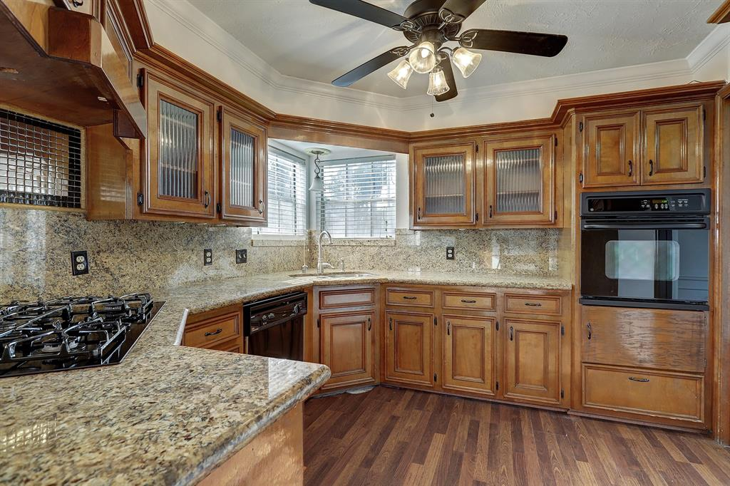 The kitchen was thoughtfully updated with granite counters and glass front cabinets.