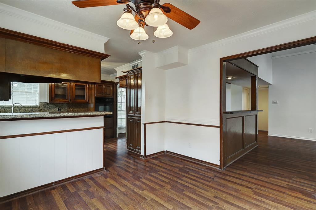 One last perspective showing the fabulous flow from breakfast space to the living room, kitchen and dining room.