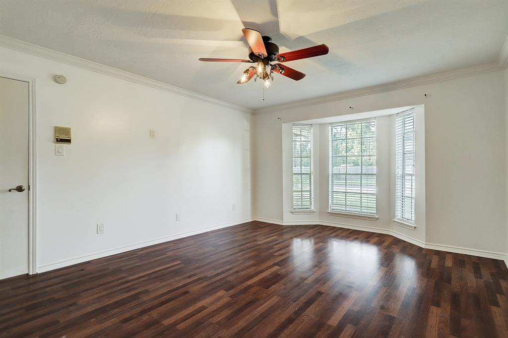 Located in a quiet corner of this home, the primary suite is spacious and bright!