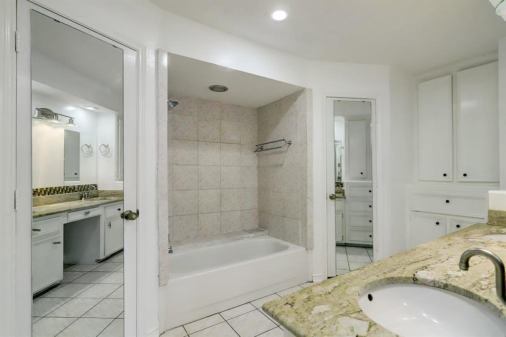 The primary bath also has two walk-in closets (mirrored doors), a combo shower/tub and a private water closet (to the left, not pictured).