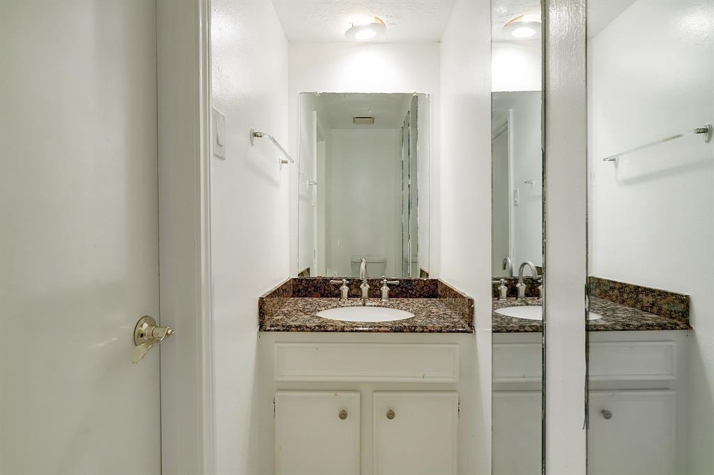 This half bath is located off the laundry/mud room on the first floor of the home, just inside the back door and adjacent to the breakfast room.