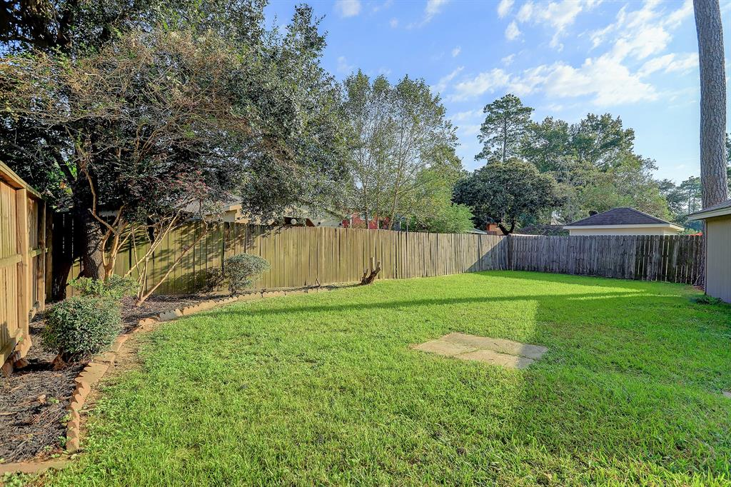 Note the privacy in this fabulous back yard.  What a wonderful spot for kids, pups and outdoor entertaining!
