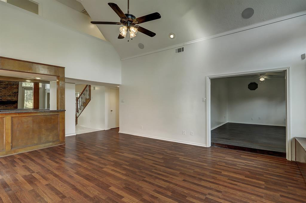 For perspective, the primary suite is located down the hall to the right on the near side of the staircase, behind the bonus room/den.