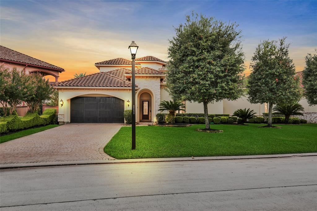 Absolutely stunning Mediterranean style smart home located in the very prestigious gated community of Lakes of Sterling Gate. Enjoy a breathtaking water view upon entry into the elegant foyer that leads into the spacious open floor-plan that's great for entertaining. Large primary suite on the first floor with private access to backyard patio area, allowing homeowners to take full advantage of the water view. Guests can enjoy the detached private suite as well as the media room located on the second floor of this magnificent home. The second floor of this amazing home also boasts a game-room and a private office that overlooks the water. New carpet throughout, plenty of cabinet space in the kitchen and spacious closets in the bedrooms. Thermador refrigerator, Generac 20KW natural gas generator that powers the entire house during an emergency,Control 4 System,Ultraviolet Air filter system,water filter system,mosquito misting system, water softener. Welcome Home!