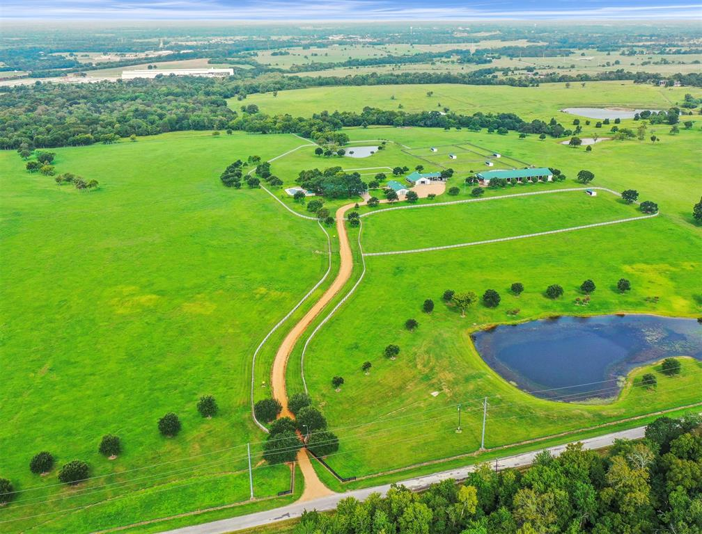 1915 TEXAS FARM HOUSE on D&S Ranch w/139.457 rolling acres, 4 ponds, scattered trees, open pastures and views for miles.  This hard to find property is located in Coshatte where many of us danced in the famous Coshatte Hall back in the day. The main residence has been meticulously updated with its own primary bedroom suite including a study/library & ensuite bathroom w/2 walk-in closets and more. The island kitchen is full of country charm & open to the dining area. The family room is oversized w/high ceiling and windows galore overlooking the custom beach entry pool. The Texas guest house is spacious w/1 bedroom, 1 bath, fam area, dining area & workout rm. Landscaping, sprinkler system & lg trees surround the home. The 4 stall horse barn w/tack rm, half bath and storage area has lg attached equipment barn. The covered riding arena, round pen, corrals & sheds make this a desirable property for horse lovers. Metal roofs are on all structures & exteriors the same. Come to the country!