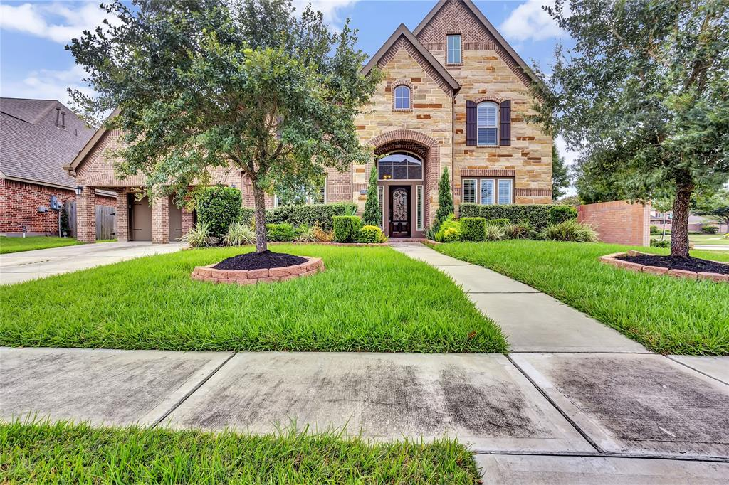 This Stunning 5/4.5 Luxury Home is an appropriate reward for your success! Featuring a Grand entrance, an impressive Great Room w/soaring ceilings & massive 2 story windows, formal living room, tasteful dining room, sophisticated Butler's Pantry, luxurious master retreat w/ 2 story ceilings and stylish master bathroom, downstairs guest suite with well appointed bathroom, oversized utility rm..too many amenities to mention. 2nd Floor features a marble top & backsplash computer desk, built-in book case, spacious game room and a media room with an additional 3 bedrooms & 2 bathrooms. The chef in your family will love this decorator kitchen featuring oversized island with gorgeous marble countertop, stainless appliances, sub-zero refrigerator & storage galore. 3 car garage, corner lot, lush landscaping and so much more will make this home the perfect place to call home. No flooding! This home won't last- CALL NOW