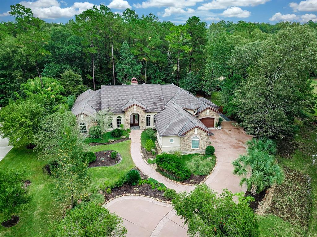 Sprawling 1 1/4 ac luxuriant lot situated on a quiet cul-de-sac in the Estates of Benders Landing. Enjoy this lush oasis-like retreat, featuring a spa pool, sunroom, tall & mature pine trees, as well as much appreciated PRIVACY! Grand entry leads to a splendid ambiance showcasing intricate woodwork, hardwood flooring & beautiful light fixtures. Discover the formal dining or private study on either side.  The heart of this home is its gorgeous kitchen open to the family room, crowned by an elegant vaulted-ceiling, promoting a stunning fireplace that opens to the island kitchen. Built with attention to detail this home provides so much storage, including an extra room w/ floor to ceiling shelving. Amazing chef's kitchen featuring gorgeous granite, beautiful cabinetry with pull-outs & spice racks, high-grade stainless steel appliances, including a 6-burner dual-fuel stove/oven & TWO full-size ovens! Check out the coffee bar in the pantry and a much-appreciated mudroom niche for damp days.