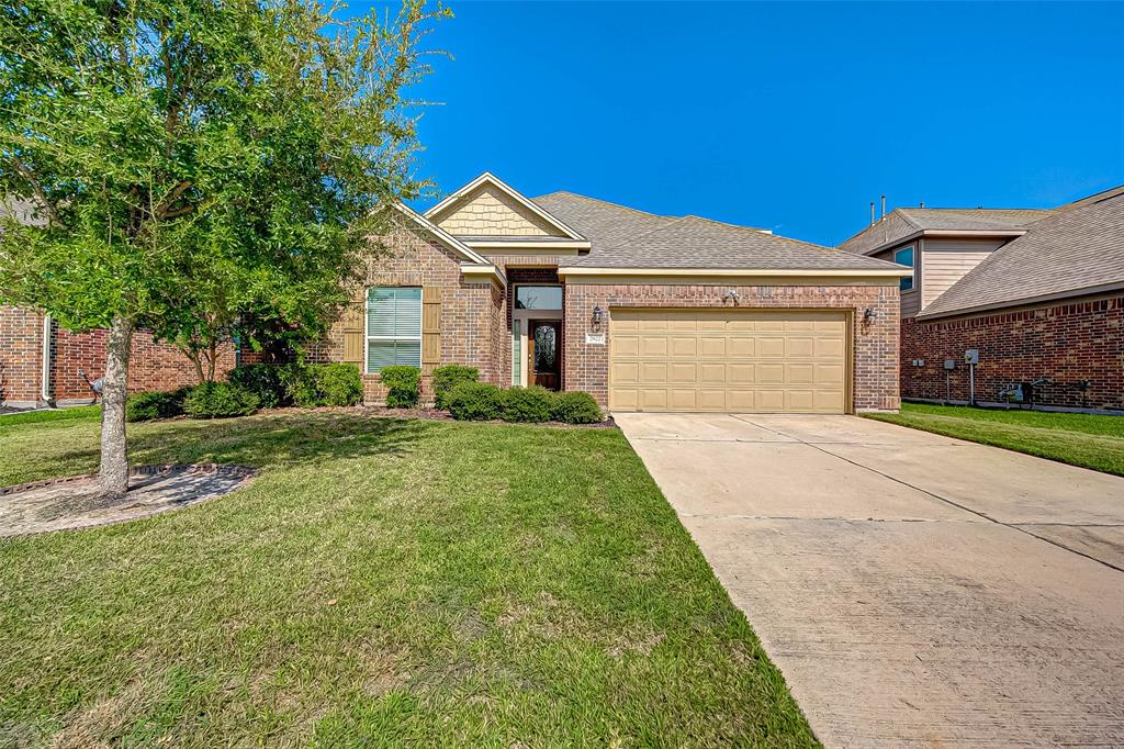 WOW! Take a look at this remarkably kept home in the highly desirable GATED section of Briarwood Crossing! Less than 2 miles to Highway 59! Close to shopping and easy access for commuting into Houston! This large home features an ideal SPLIT PLAN layout. All bedrooms are located downstairs! Upstairs is a large GAME ROOM perfect for entertaining family and friends! The chef of the family will fall in love with the large kitchen with tons of COUNTER SPACE, including a serving island! You'll be cooking with GAS in this kitchen! Large living room with gas FIREPLACE! FORMAL DINING ROOM! COVERED BACK PATIO! HUGE MASTER BATH with separate soaker tub and shower! Tons of reasons why you and your family will love to spend time together in this home! Make your appointment today!
