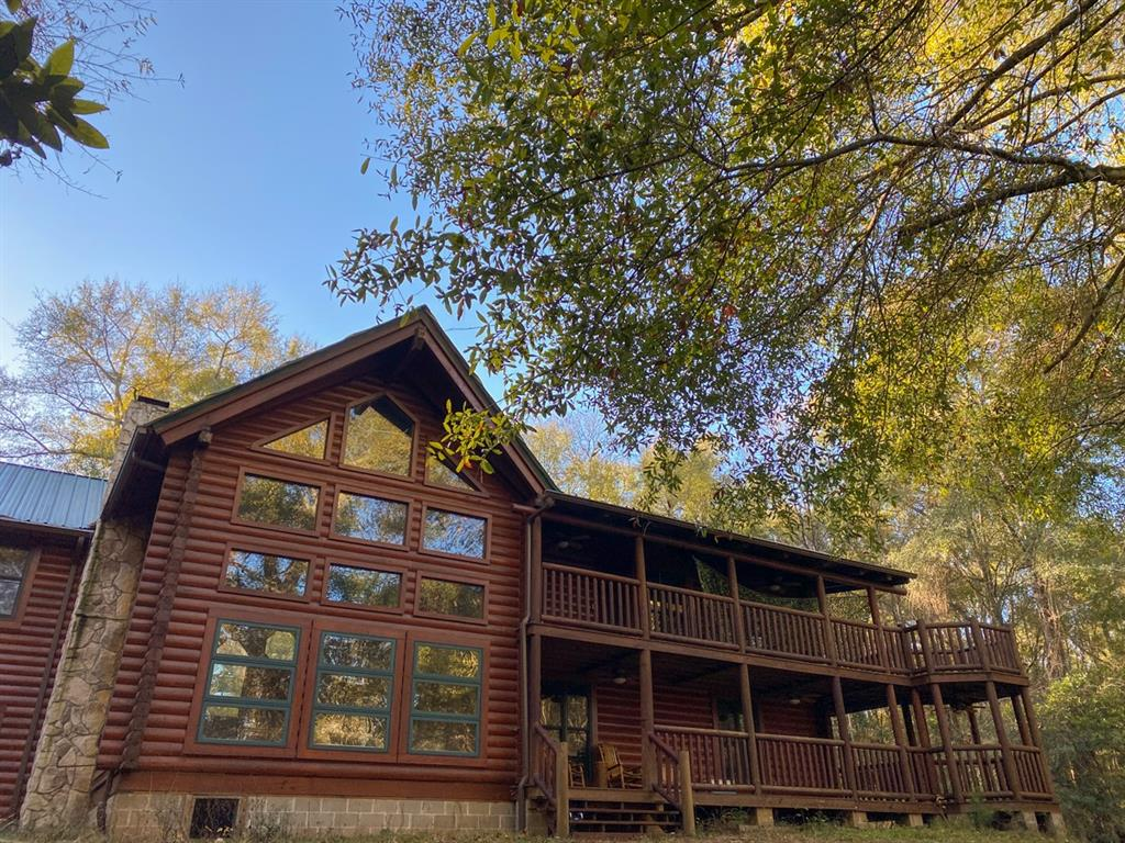 Private and secluded! This property is accessed from Oak Ridge Road, which dead ends, providing a quiet atmosphere with little traffic. One of a kind log cabin with a grand living room, den, dining, and bunk room along with 4 bedrooms and 3 bathrooms. 2 story porches overlook the dense woodlands sloping down to Turkey Creek. Outdoor enthusiasts dream ready for hunting, hiking, recreational shooting, or a simple weekend getaway with lodging already available!
