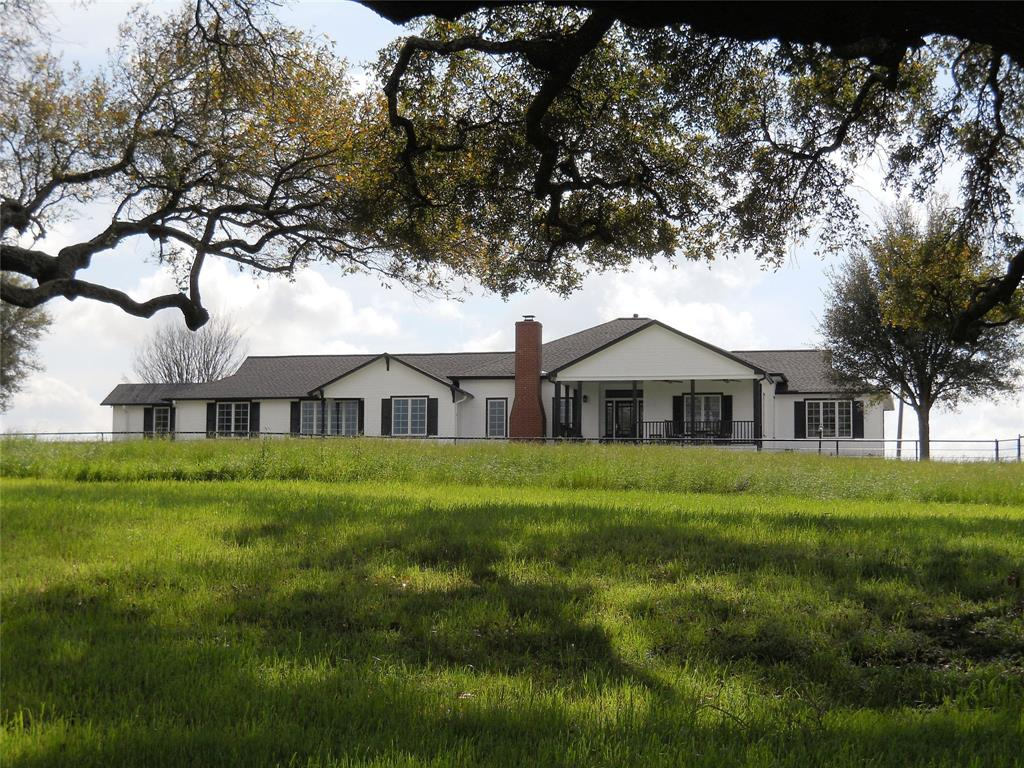 Restored Texas farmhouse  atop a scenic 400° hilltop on 12 acres w Bermuda grass & dotted w massive live oaks & a pond. The twisting spring fed creek serves as the N border to the tract. Restoration occurred 1996 & and in 2011 an 1875 sq. ft. addition was added. Current owners remodeled & updated Kitchen & appliances, 3 1/2 bathrooms, laundry rm, repainted inside & out & built 30 x 40 workshop in '19.   French doors from living room open into the L-shaped Breakfast Room, Den & Kitchen.  3 BRs & 2 BA adjoin Den area, Master BR, Study & Master BA wing off the Living Room. Amenities: Leaded glass ft. door~wood burning FP~Pine floors~Anderson Crank windows~crown molding~ceiling fans~recessed lighting~2 Glass door Butler counters~Kohler under-mount sink ~custom cabinets w roll-out drawers~Silestone counters w marble back splash~4-burner gas cook top~Dishwasher~Trash Compactor~Stainless built-in Oven~Microwave~New roof 2019~Black pipe fencing~Barn~Tax ID #19427. Add'l acreage available.