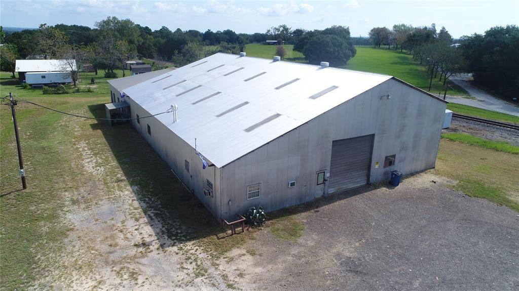 Buffalo Shop on HWY 79 -  Great Shop located in Buffalo with all city utilities available. The building has numerous functions for an ideal work shop including - 9800 Total sq. ft,  70x100 concrete floor, 240 - 3 phrase electric service, 7.5 ton bridge crane, 50x100 crane coverage, 3 phase Ingersoll rand air compressor,  Air and electric plumbed thru shop, .892 acres with rail and Hwy 79 frontage, Office with restroom, 2 Lockable tool rooms with shelving, City Water and sewage. Great Property with many uses.