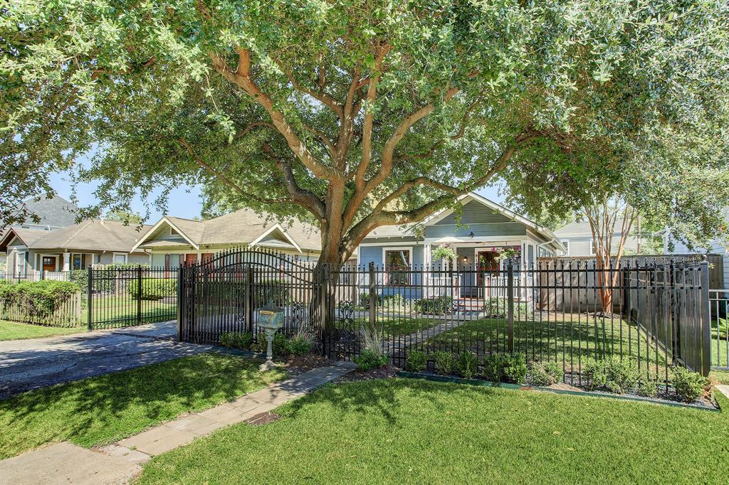 This picture perfect 3/2 bungalow sits in the epicenter of The Heights on a fully fenced lot with a beautiful live oak in the front yard!