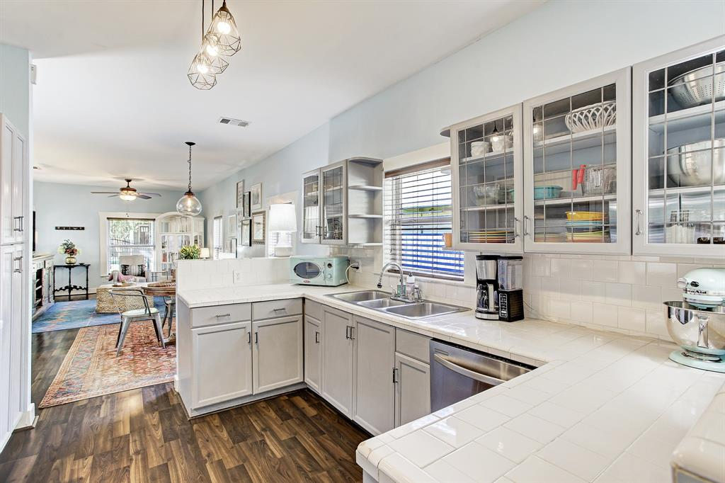 There is very good counter space here and potentially room for a small island if needed. And who doesn't love a window over the sink, overlooking one of the side yards?