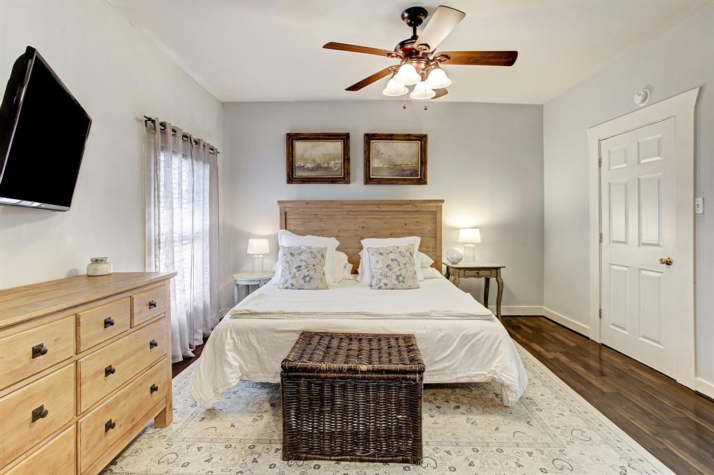 This bedroom very comfortably fits a king bed, as well as dressers and side tables.