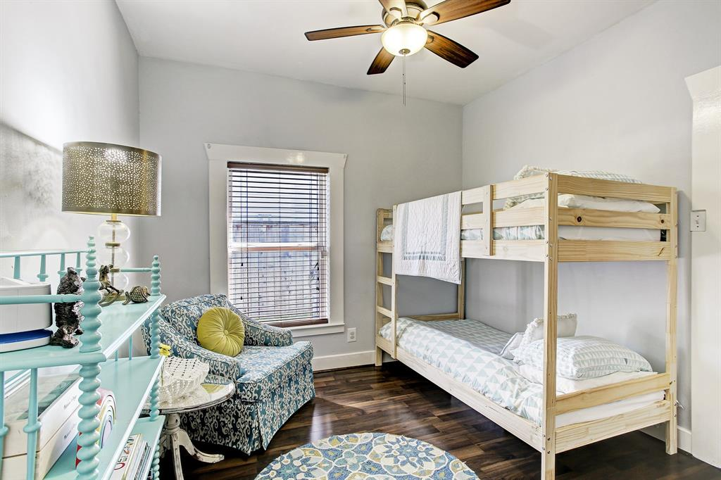 The second bedroom sits in the middle of the home, and set up with bunk beds really makes for a wonderful kids' room including a book shelf.