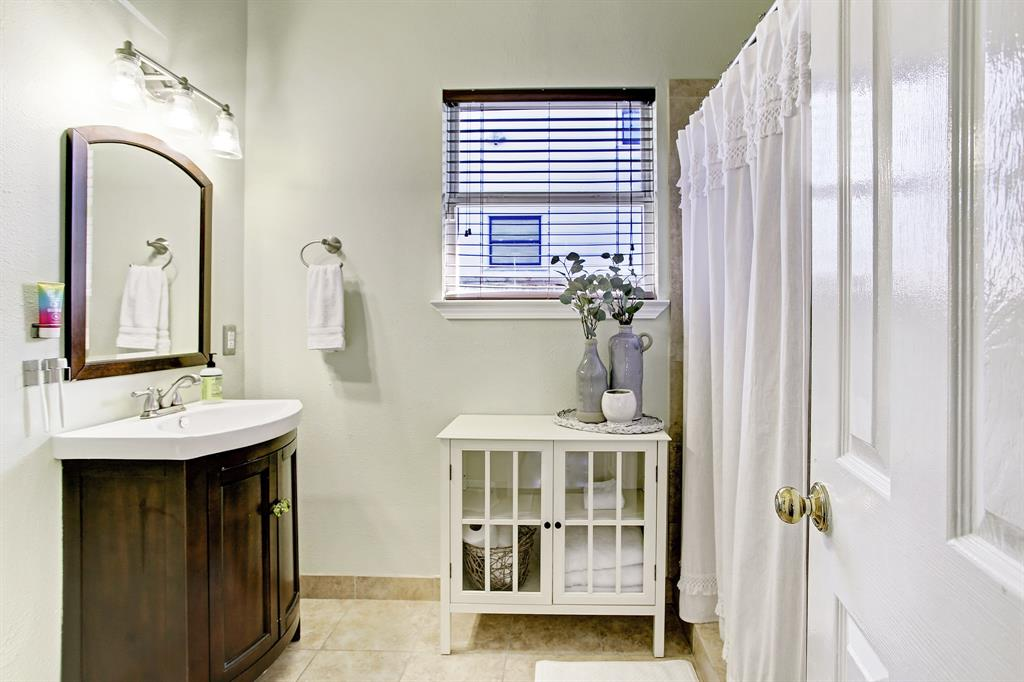 The second full bath is spacious, with a window to the side yard.