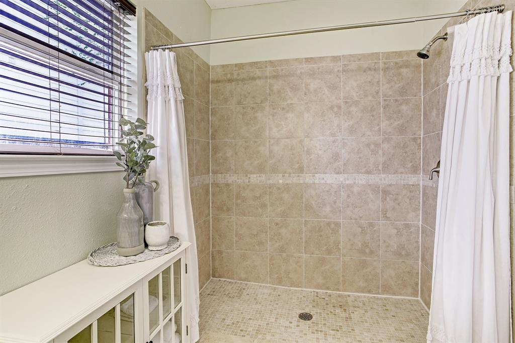 The big shower stall is walk-in.