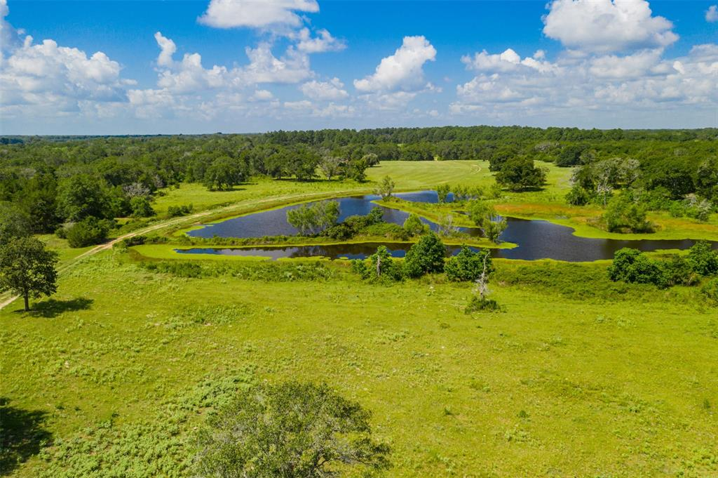168 acres offered for the first time out of the historical Tidwell Ranch. This property includes a beautiful Three-acre lake, one smaller pond and a great mis of open rolling pasture and thick forest. The ranch is a one-hour drive from West Houston and less than two hours from Austin. The ranch is ideally located in the Houston/Austin corridor and includes almost 2,000 feet of frontage on FM 1094. The property is rolling terrain with open pastures near the front and turns into a mix of large oaks, pines and elms as you venture further back on the property.  There are currently no water wells on the property but the groundwater here is plentiful and relatively shallow. There is a small pond in the front pasture and the large lake is located in about the middle of the property. The lake is clear and stocked for great fishing and is a beautiful body of water. Plenty of deer, hogs and dove are on the property.