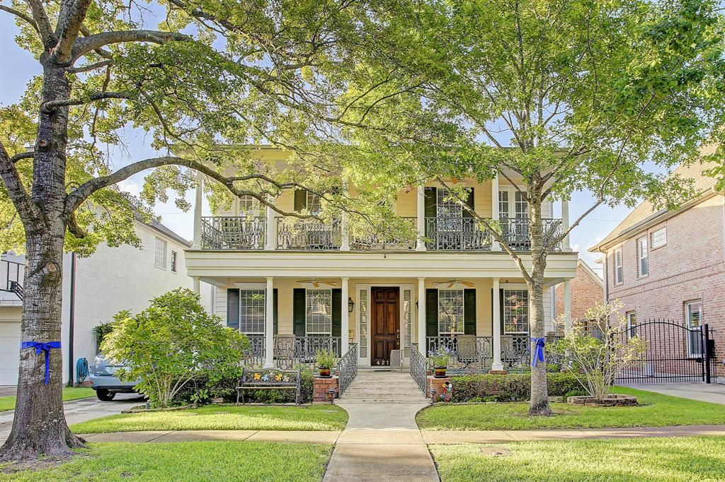 A truly unique Greek Revival style home with covered porches up and down, front and back.  Downstairs study/bedroom with full bathroom, lovely  formal dining room, large family room with fireplace, great kitchen with huge island opening into the family room, this open plan allows for ease of entertaining, large master bedroom with lovely master bathroom and large closets. Back porches overlook great fully fenced backyard. Hardwood floors throughout, granite counters, large secondary bedrooms, beautiful custom cabinetry, a warm and charming home within walking distance to parks, pools, rec center, school, Little League Field, tennis courts and Whole Foods!!
