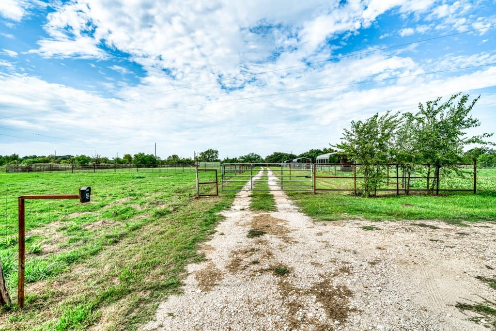 5.9 Acres located just outside the Bryan city limits and less than 2 miles to Highway 6 and city conveniences. 3BR/2BA manufactured home with new flooring throughout. Currently used as a horse property and features 7 turnout paddocks with lean to sheds. Additional pasture for larger turnout. 130 x 270 ft panel fenced team roping arena. Barn kit and 1,000 ft of pipe will convey. Property offers tremendous upside potential as horse boarding/training facility, investment property or your personal residence.