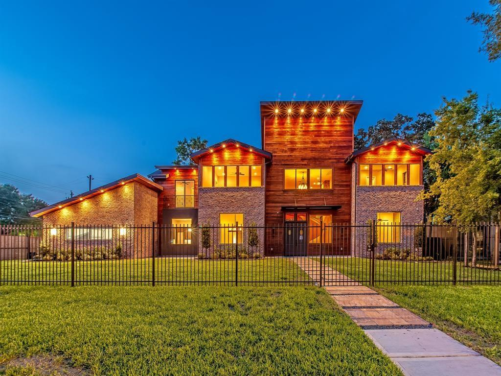 "Stunning old world design meets luxe new age tactical execution in one home. This custom home brings both worlds together in stunning fashion. The residence features a full Tiger Wood facade imported from Africa, massive chef's kitchen, dedicated wine room with a 9-ft glass wall, a full outdoor kitchen with exterior wood burning fireplace, an elegant white tiger runner, and custom ironwork with Creole touches. No stone has been left unturned: interactive mirrors, a hidden safe, a live edge acacia table, and bench from Arka Designs is to stay with the home, security cameras to stay,  as well as brand new Roman Shades and drapes, tons of "" 3-D"" walls finished with brick and tile. Minutes from the medical center, downtown, and the Galleria. The 3rd Ward/Medical Center community offers something many communities do not: a rare chance to become a part of the fabric of the community and build lifelong professional and personal relationships."